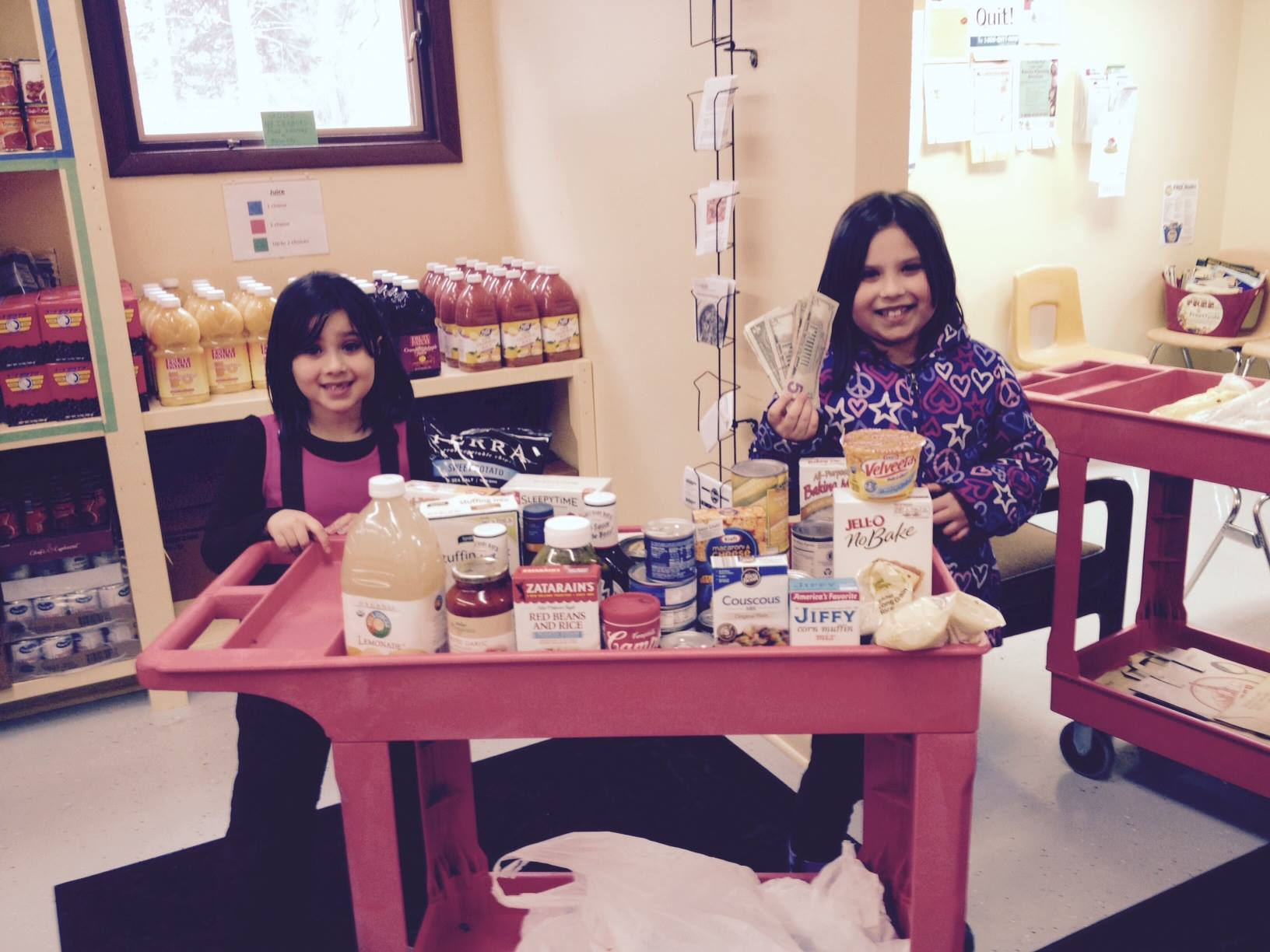 Two girls posing with their donations
